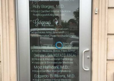 Roly-Borges-office-Directory-on-glass-door
